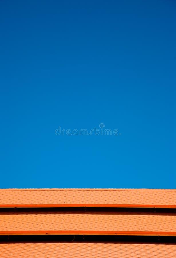 Blue sky orange tiles stock images