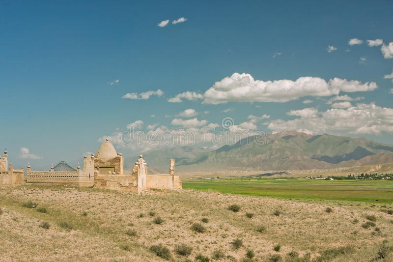 Blue sky over old Muslim graveyard in a mountain village stock photos