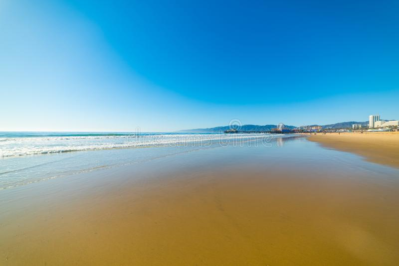 Blue sky over Santa Monica golden shore. Los Angeles county. California, USA royalty free stock photos