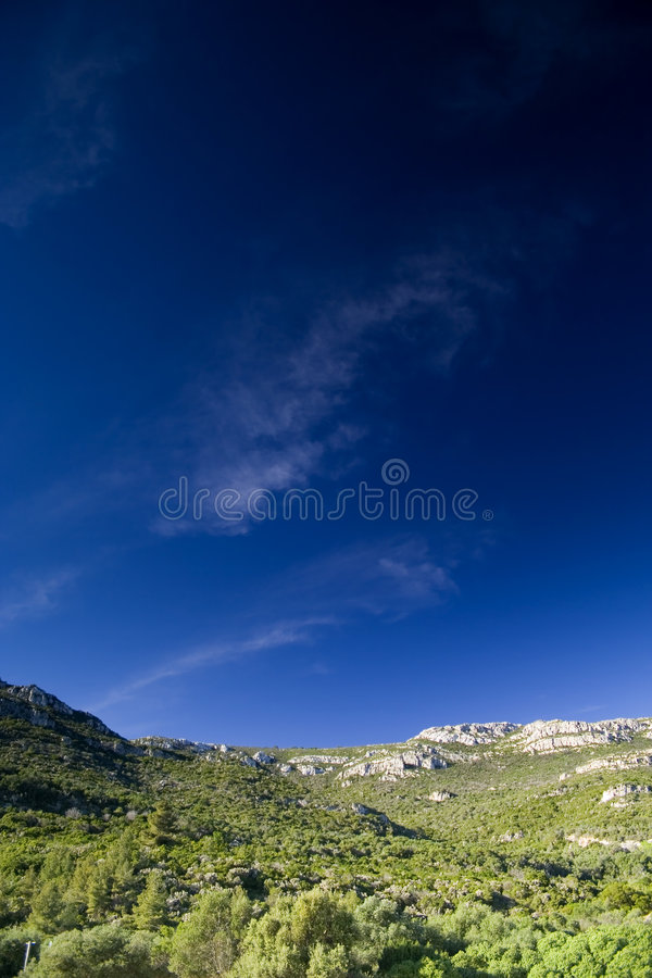 Free Blue Sky Over The Rocks Mountain Stock Photo - 2094510