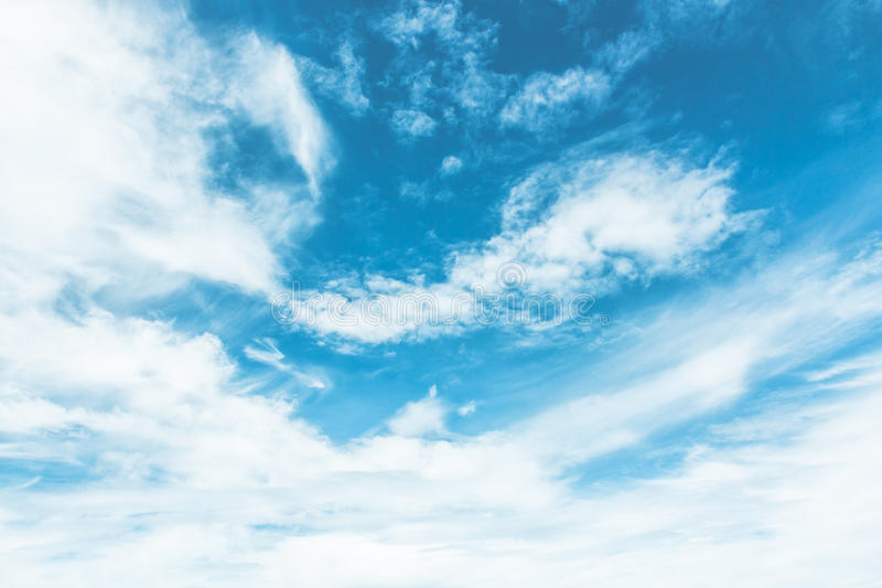 Blue sky painted with white clouds royalty free stock photo
