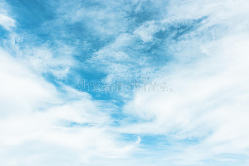 Blue sky painted with white clouds royalty free stock photography
