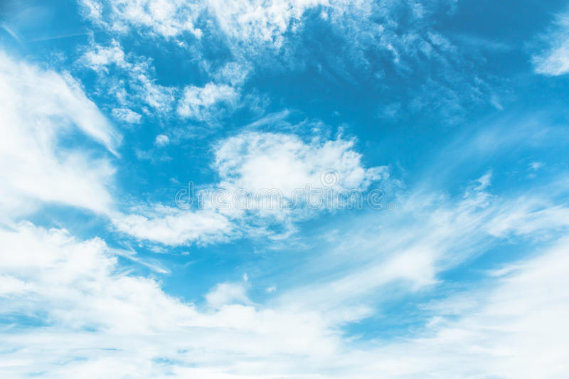 Blue sky painted with white clouds stock image
