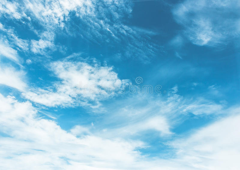 Blue sky painted with white clouds royalty free stock image