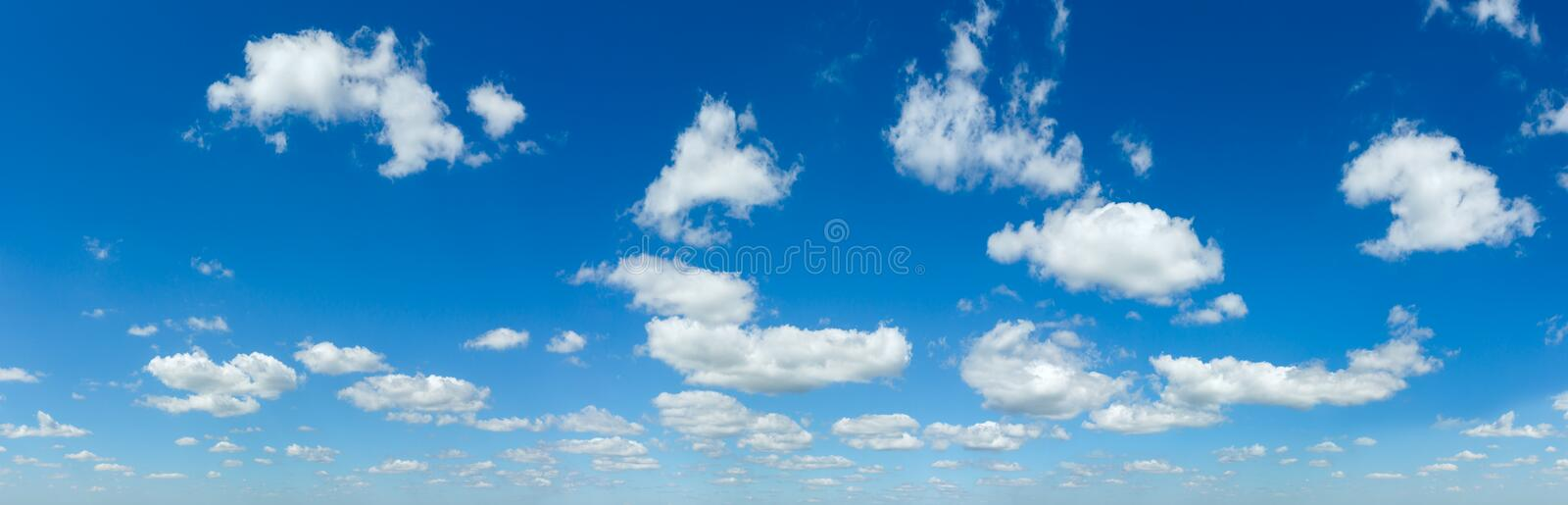 Blue sky panorama with white clouds royalty free stock image