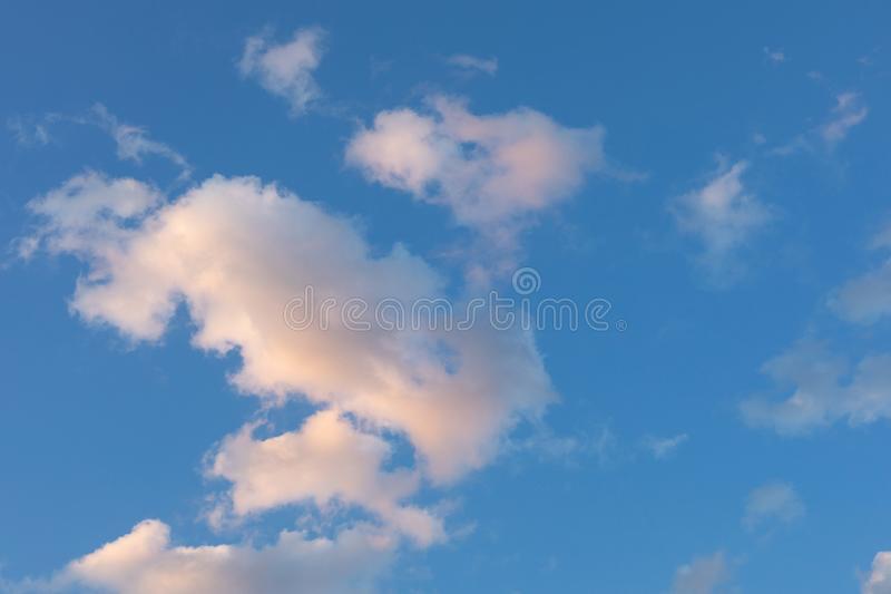 Blue sky with pink clouds for backgrounds beautiful sunset royalty free stock image