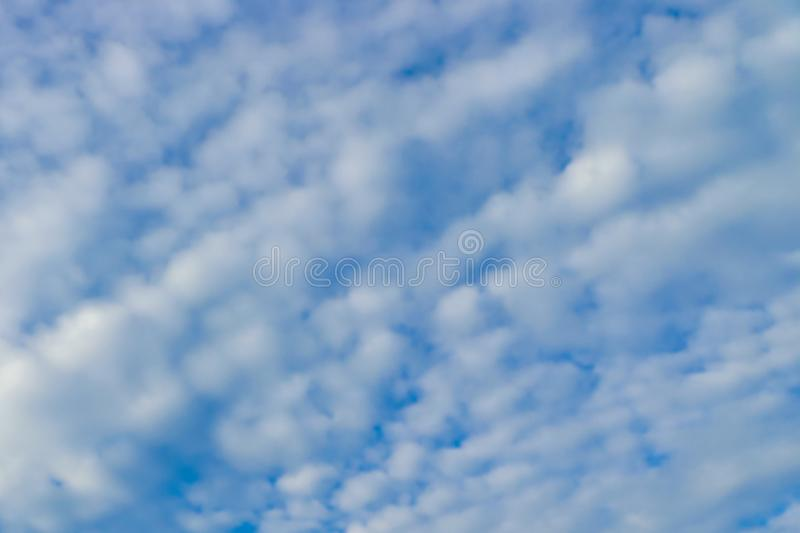 Blue sky and powdery clouds background. Baby blue sky and powdery, white clouds background. Imagination, day dreaming, inspiration royalty free stock photography