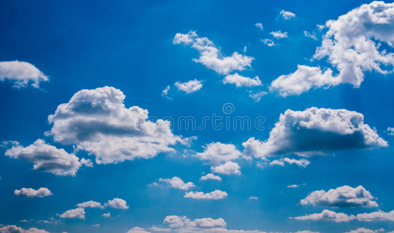 Blue Sky and puffy clouds royalty free stock photo