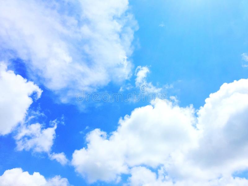 Blue sky with puffy white clouds royalty free stock photos