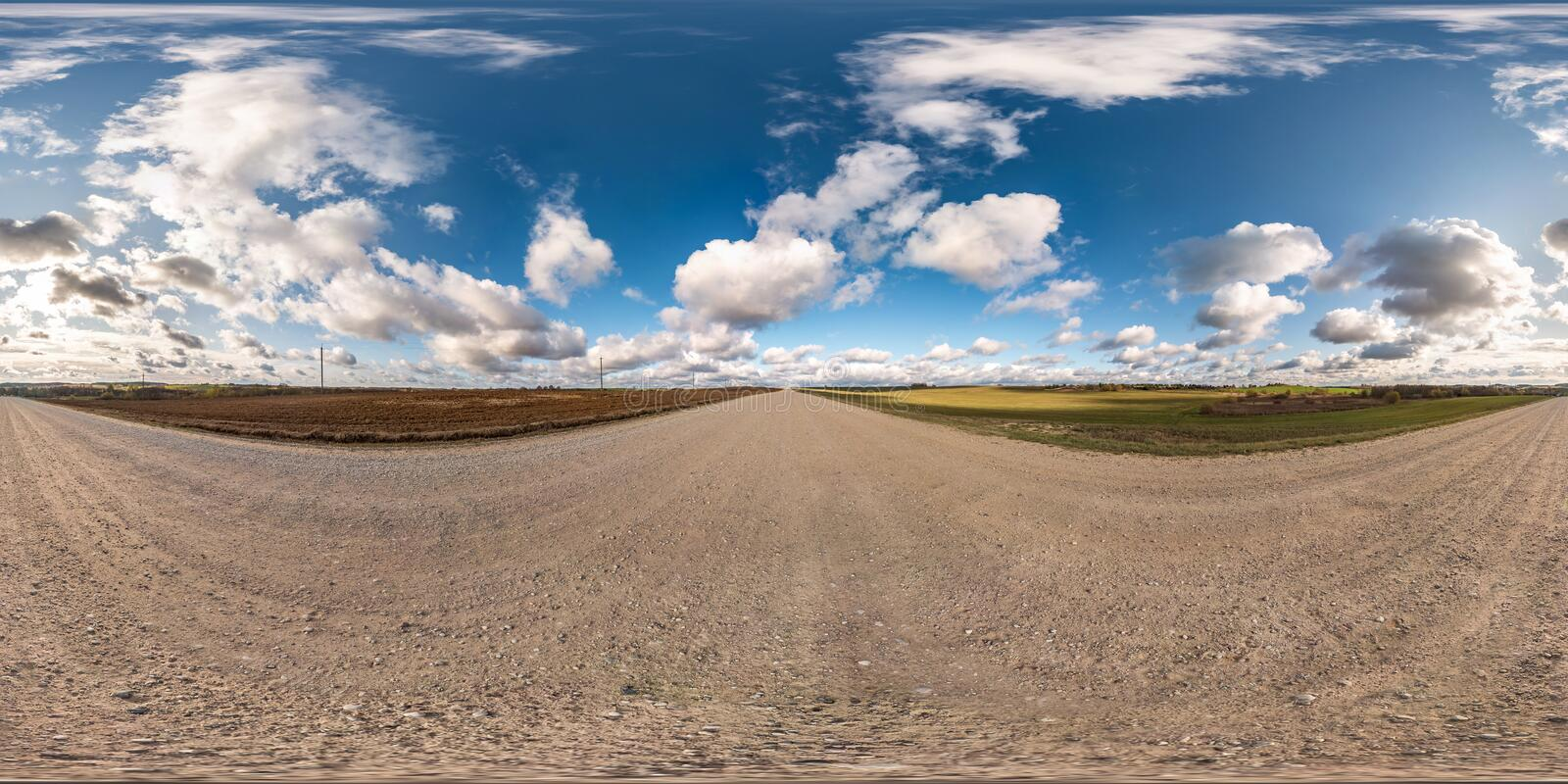 Blue sky with rain storm fluffy clouds. full seamless eamless hdri panorama 360 degrees angle view on gravel road with zenith in royalty free stock photography