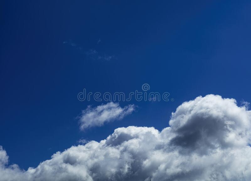 Blue sky with rayny clouds high angle view royalty free stock images