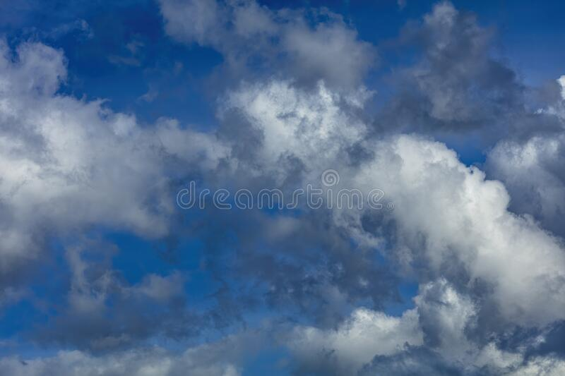 Blue sky with rayny clouds high angle view royalty free stock photos