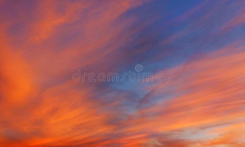 Blue sky and red clouds. Blue sky and red clouds royalty free stock images