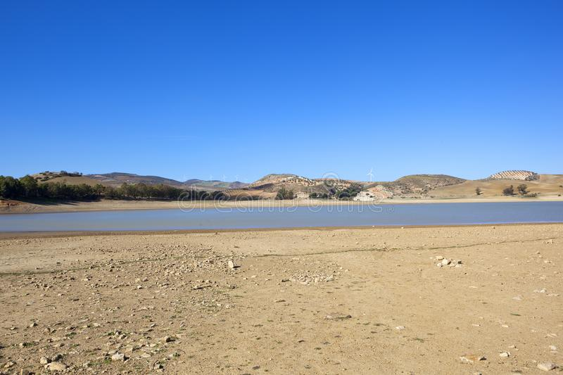 Blue sky reflected in an Andalucian reservoir royalty free stock images