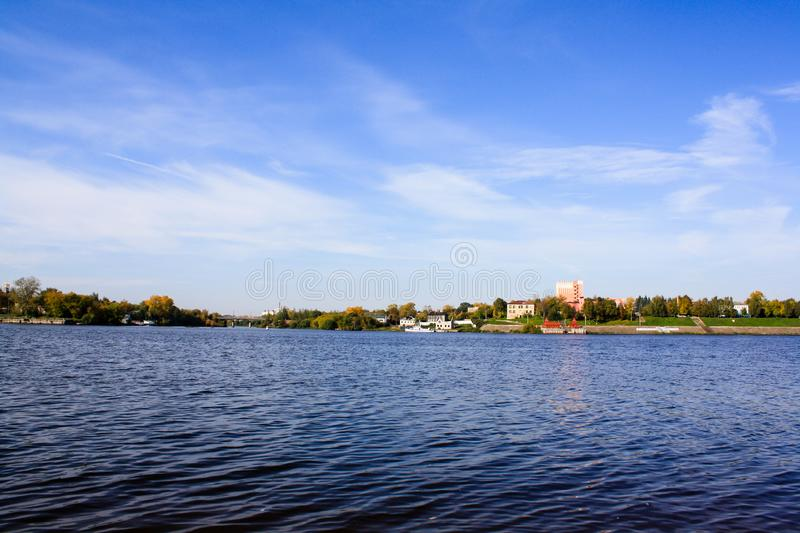 Blue sky, river and city on the shore.  stock images