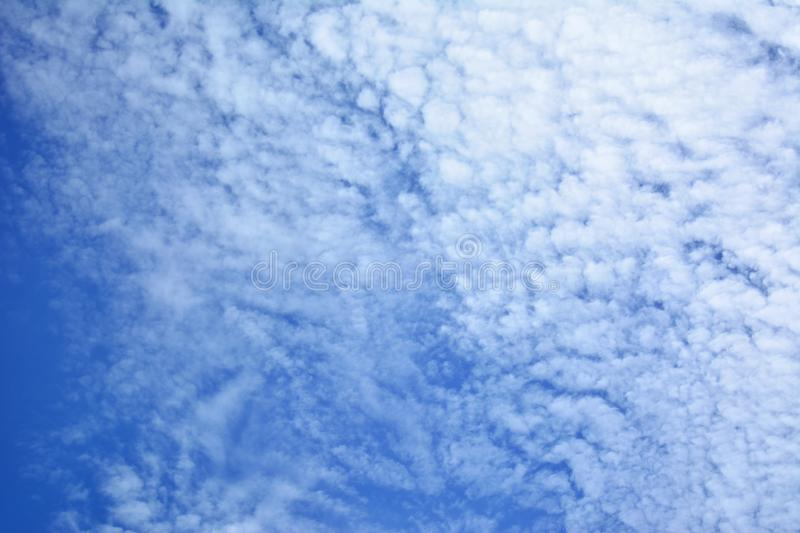 Blue sky, scattered clouds on a bright sky stock photos