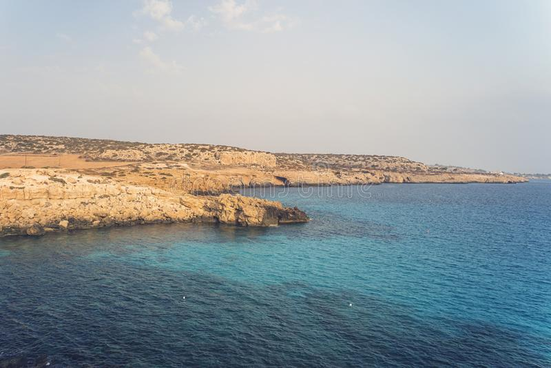 blue sky. sea rocks and rocks on beach of Aphrodite. Cyprus. Mediterranean sea royalty free stock photos