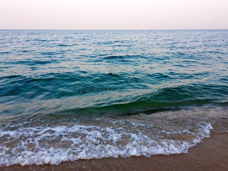 Blue sky sea sand background stock photo