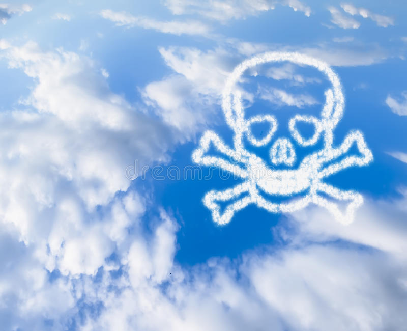 Blue Sky with a skull and bones in the clouds. The blue sky with the symbol of the skull and bones from the cloud stock photos