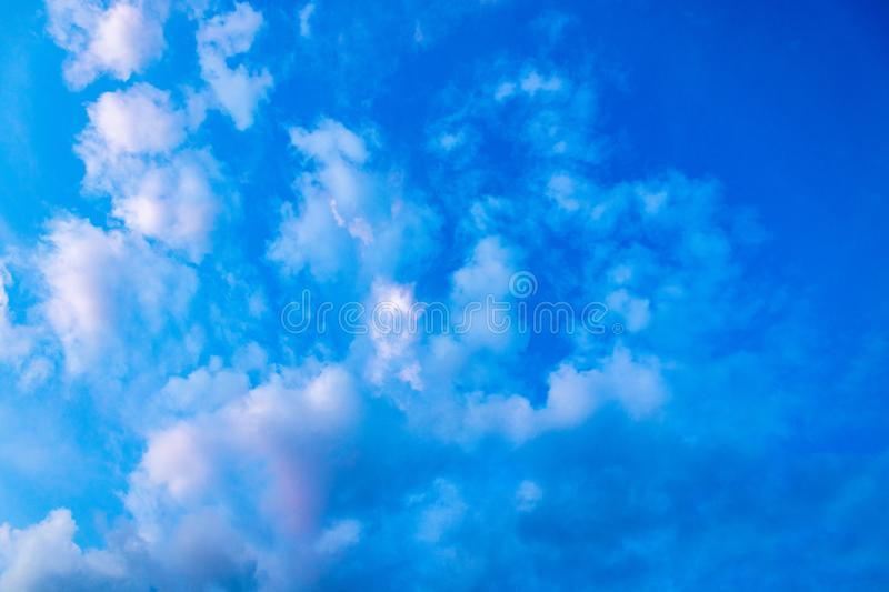 Blue sky with small clouds on a beautiful Sunny day. as a background royalty free stock images