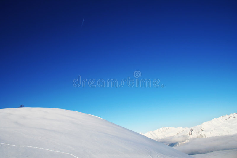 Blue sky and snow. Blue sky and white snow in swiss Alps stock photo