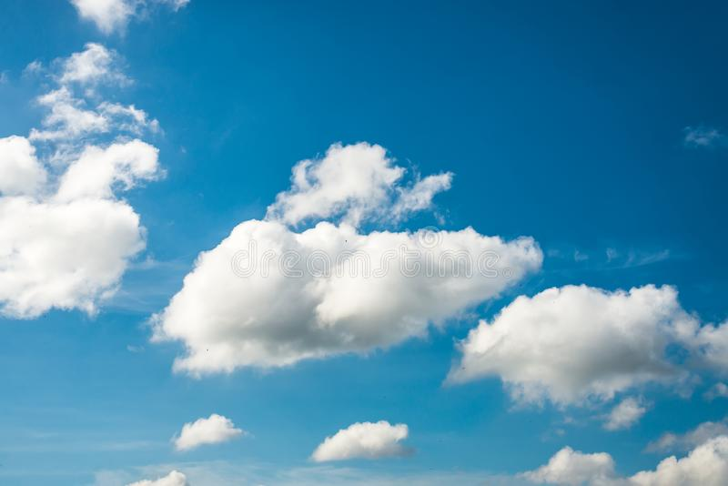 Blue sky with soft clouds and beautiful day of sun. stock images