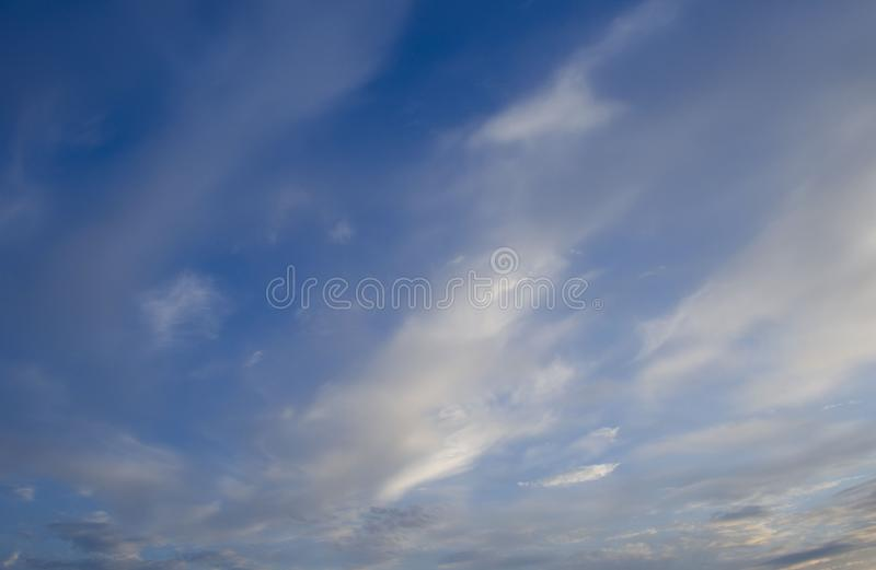 Blue sky with soft clouds. View of blue sky with soft clouds on a sunny summer day royalty free stock image