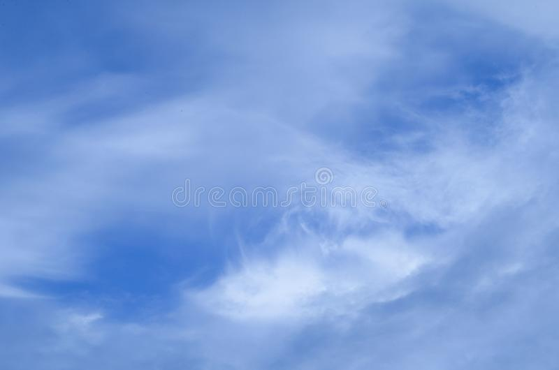 Blue sky with soft clouds. View of blue sky with soft clouds on a sunny summer day stock photo