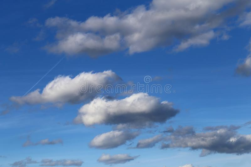 Blue Sky with Some Cotton Candy Clouds. Beautiful blue sky with some white cotton candy clouds during a sunny spring day. Very relaxing and lovely atmosphere stock photography