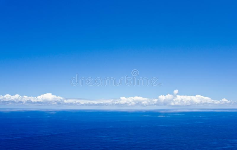 Blue sky with some white clouds above the atlantic ocean stock photos