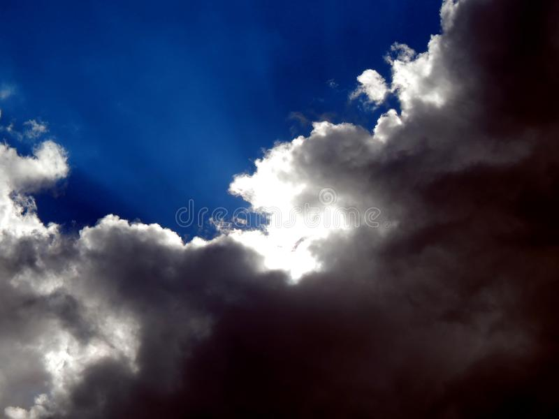 Time the beginning of a strong storm with a hurricane. Blue sky during a strong start to a stormy sky close up stock photos