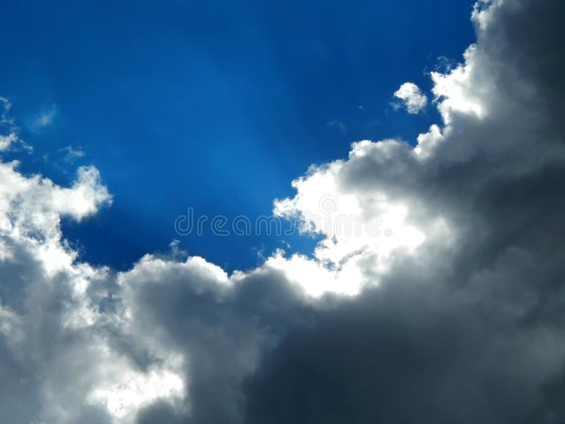 Time the beginning of a strong storm with a hurricane. Blue sky during a strong start to a stormy sky close up stock photography