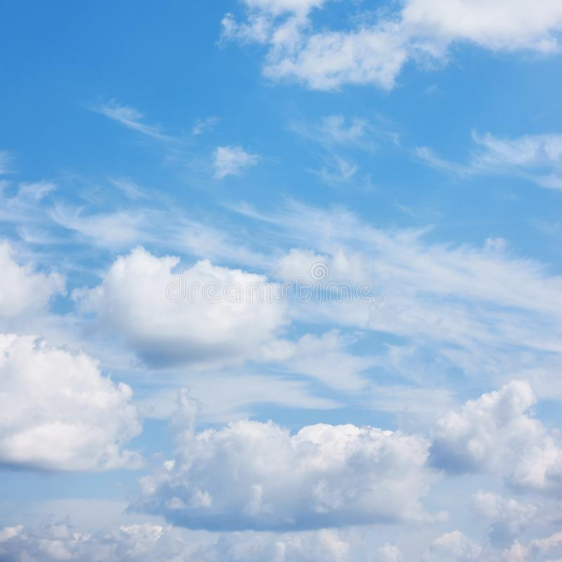 Blue sky with summer pile clouds stock images