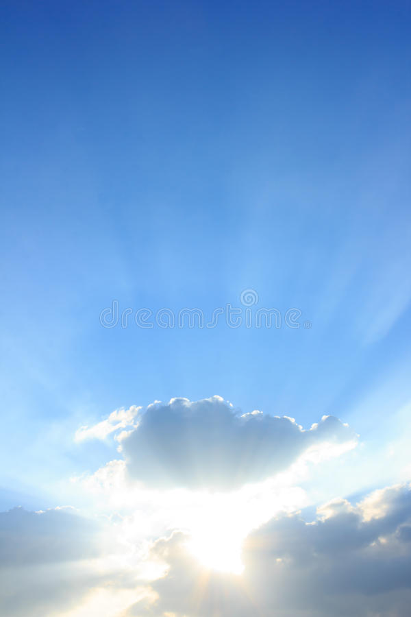 Blue sky with sun and clouds. For background royalty free stock photo