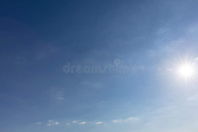 Blue sky with sun and few clouds royalty free stock photos