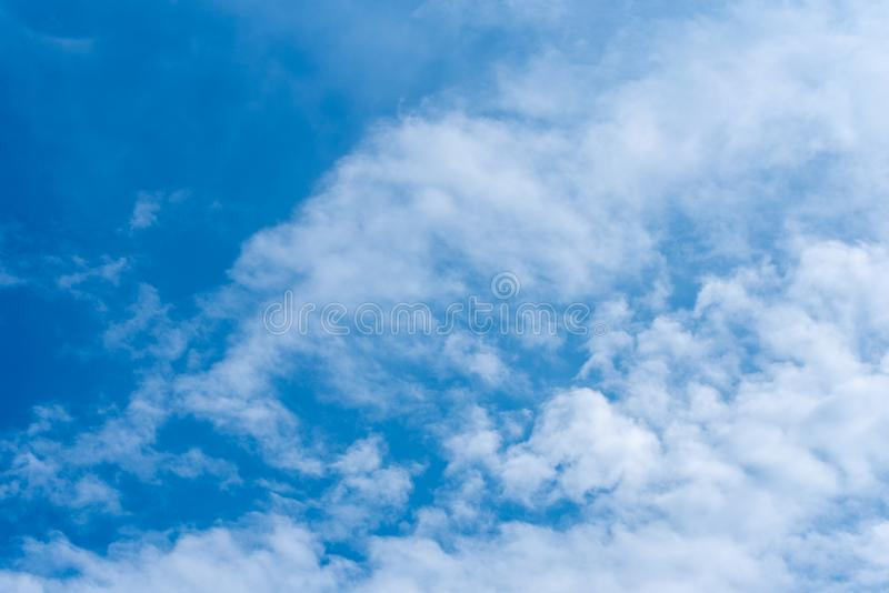 Blue sky in sunny day with white puffy clouds. Natural background stock photos