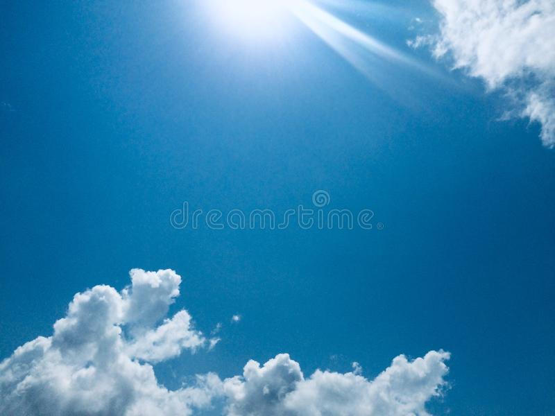 Blue sky with sunshine and clouds royalty free stock images