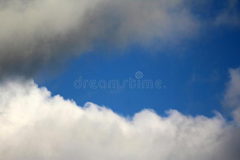 Blue sky surrounded by clouds royalty free stock photos