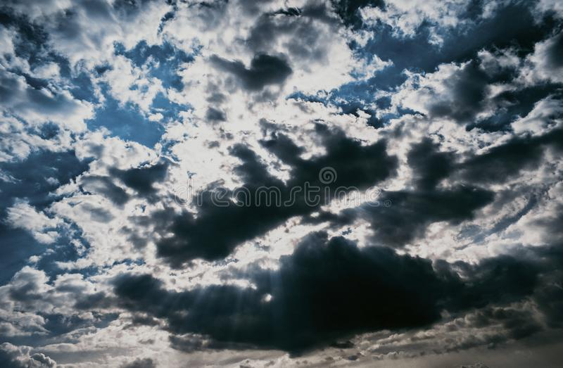 Blue sky texture with gloomy clouds. Design wallpaper with space for text stock images