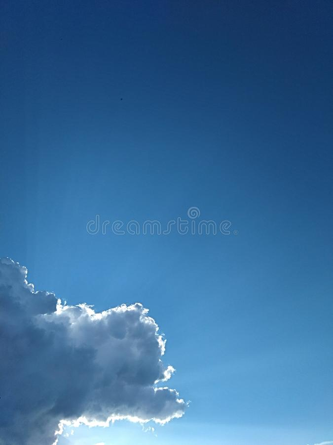 Blue sky from under a rain cloud royalty free stock images