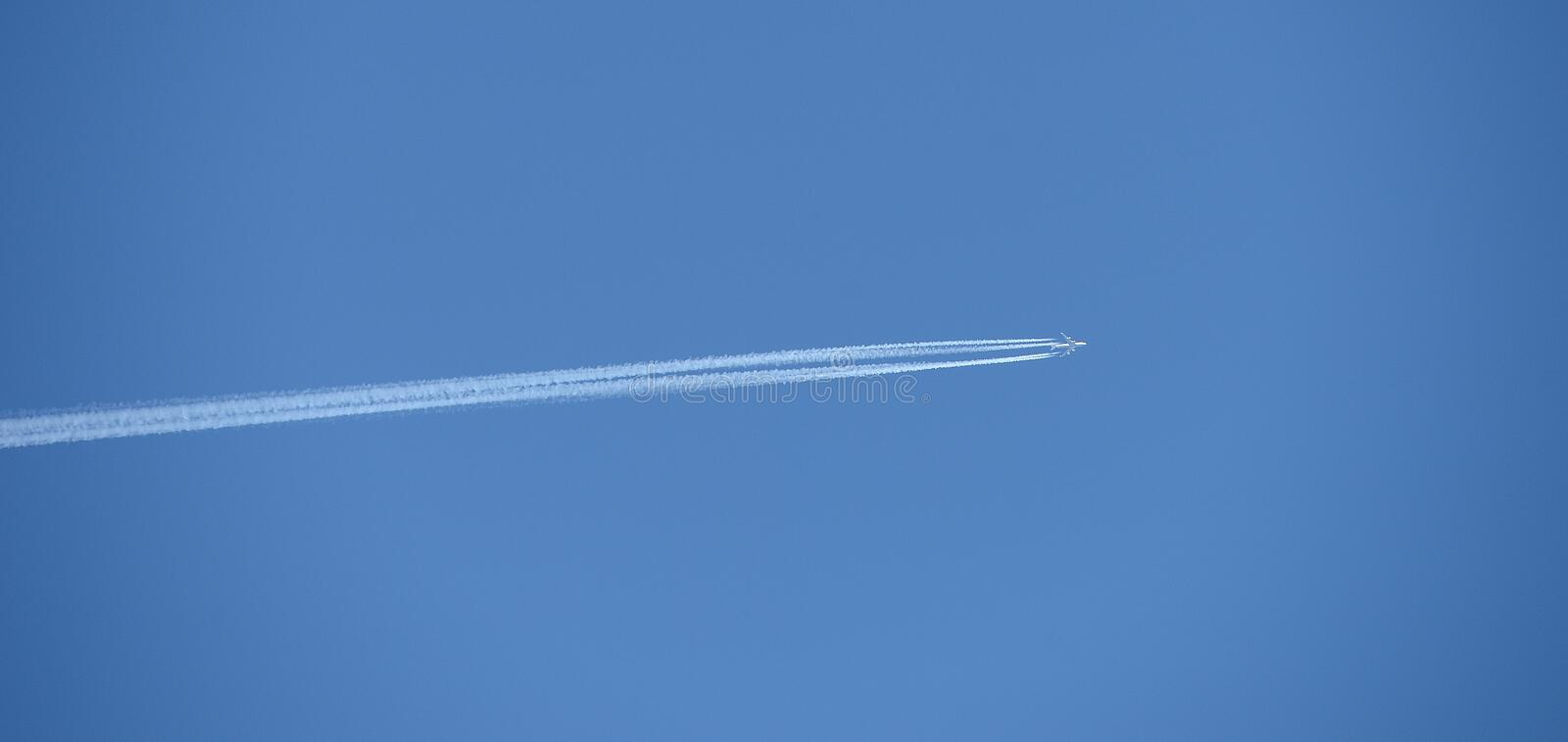 Blue Sky With Vapor Trail Stock Image