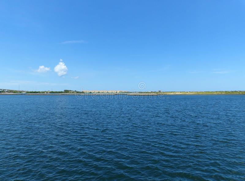 Blue Sky and Water royalty free stock images