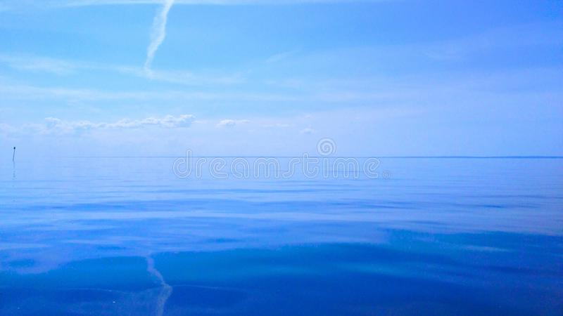 Blue sky and water stock photo