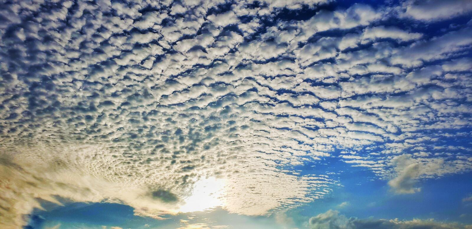 Blue sky and the wave of clouds stock photos