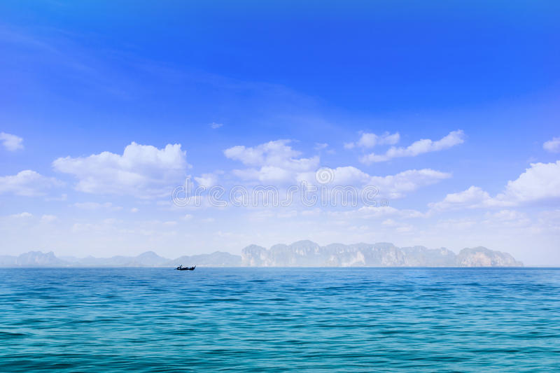 Blue sky and white cloud above the ocean and long island stock images