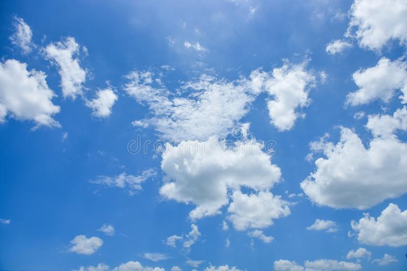 Blue sky white cloud white background. Beautiful sky and clouds in the afternoon royalty free stock image