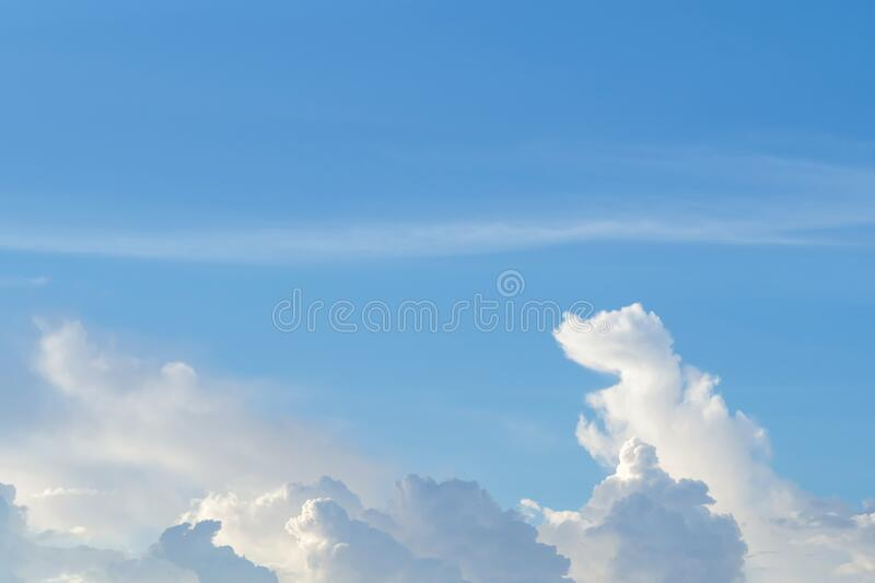 Blue sky with white clouds background. natural cloud shaped like an imagination dragon in the sky.  royalty free stock photos