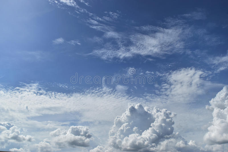 Blue sky and white clouds on a beautiful day and empty space for web design or graphic art image. Blue sky and white clouds on a beautiful day ,empty space for royalty free stock photography