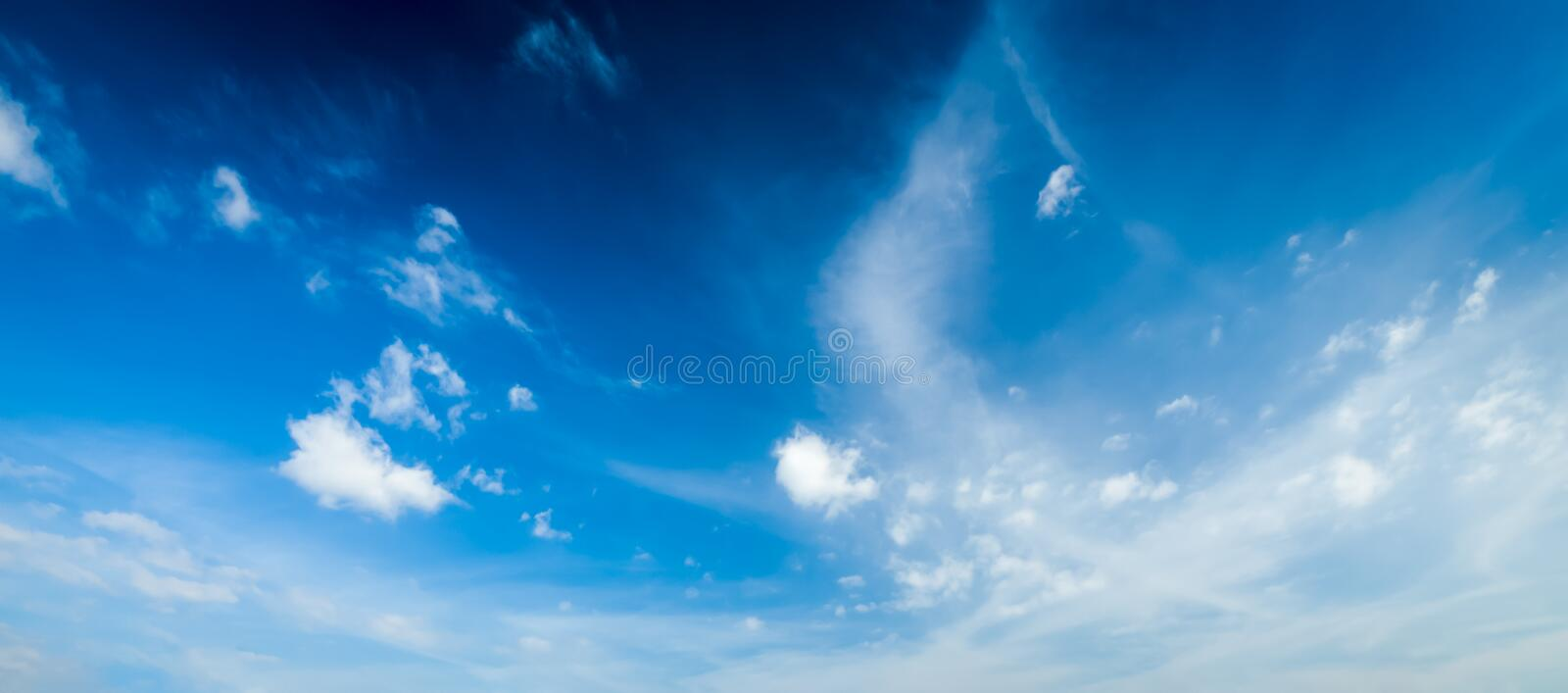 Blue sky with white clouds royalty free stock photos