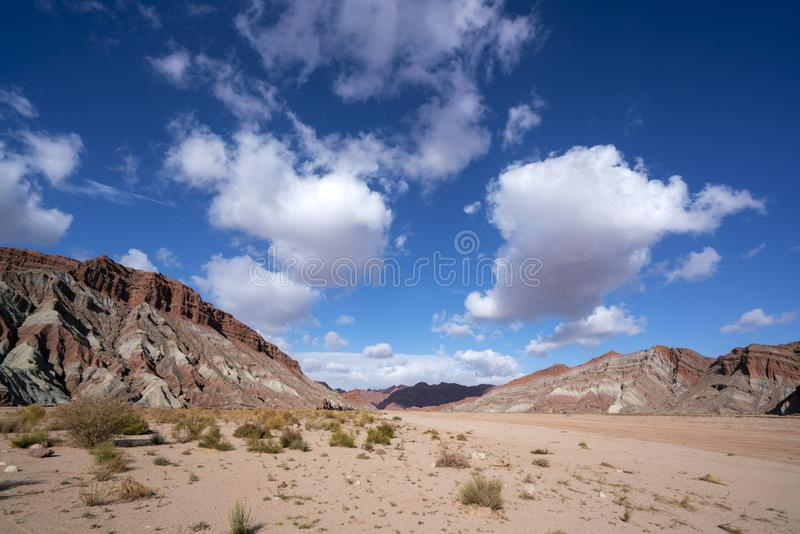 Blue sky white clouds and colorful Wensu Grand Canyon in Autumn royalty free stock photo